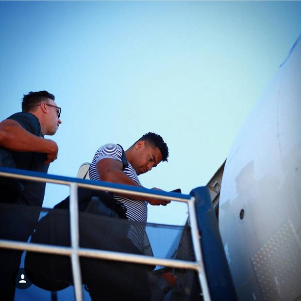 The Winnipeg Blue Bombers deboard a plane.