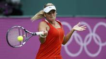 Canada's Aleksandra Wozniak returns to Venus Williams of the U.S. in their women's singles tennis match at the All England Lawn Tennis Club during the London 2012 Olympic Games on Tuesday. (STEFAN WERMUTH/REUTERS)