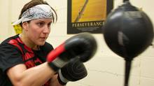 World Welterweight Champion, Mary Spencer hits a bag during a training session at the Windsor Amateur Boxing Club in Windsor, Ontario, May 6, 2010. GEOFF ROBINS The Globe and Mail (GEOFF ROBINS)