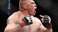 Brock Lesnar celebrates after defeating Frank Mir in their heavyweight title bout at UFC 100 at Mandalay Bay in Las Vegas Saturday, July 11, 2009. (AP Photo/Las Vegas Review-Journal, John Locher) (JOHN LOCHER)