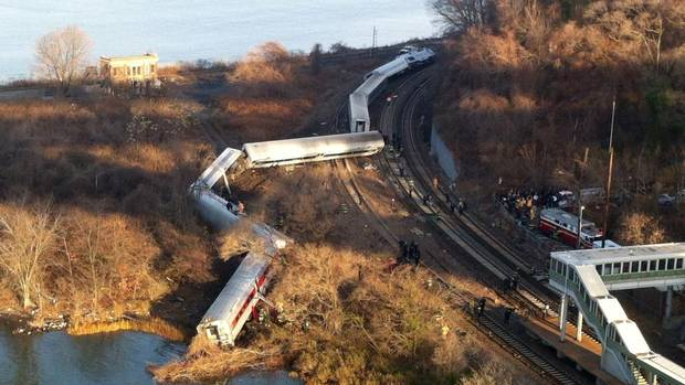 "Cars from a Metro-North passenger train are scattered after the train derailed in the Bronx neighborhood of New York, Sunday, Dec. 1, 2013. The Fire Department of New York says there are ""multiple injuries"" in the train derailment, and 130 firefighters are on the scene. Metropolitan Transportation Authority police say the train derailed near the Spuyten Duyvil station. (Edwin Valero/AP)"