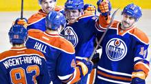 Edmonton Oilers' Ryan Nugent-Hopkins (93), Taylor Hall (4), Justin Schultz (19), David Perron (57) and Jordan Eberle (14) celebrate a goal against the Florida Panthers during second period NHL hockey action in Edmonton, Alta., on Thursday November 21, 2013. (JASON FRANSON/THE CANADIAN PRESS)