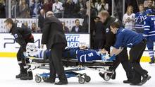 Toronto Maple Leafs' Paul Ranger is taken off the ice on a stretcher after hitting the boards head first from a check by Tampa Bay Lightning's Alex Killorn during first period NHL action in Toronto on Wednesday March 19, 2014. (Frank Gunn/THE CANADIAN PRESS)