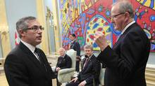 Tony Clement is sworn in as the President of the Treasury Board at Rideau Hall. (CHRIS WATTIE/CHRIS WATTIE/REUTERS)