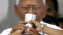 Veteran Indian social activist Anna Hazare drinks coconut water and honey to end his fast at Ramlila grounds in New Delhi Aug. 28, 2011. (Adnan Abidi/Reuters/Adnan Abidi/Reuters)