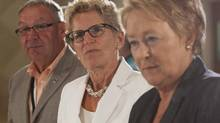 Premiers Darrell Dexter of Nova Scotia, Kathleen Wynne of Ontario and Pauline Marois of Quebec attend the opening prayer for the Council of the Federation meeting in Niagara-on-the-Lake, Ont., on July 24, 2013 (AARON LYNETT/THE CANADIAN PRESS)