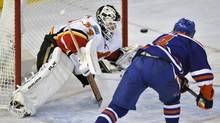 Edmonton Oilers' Taylor Hall (R) lifts the puck past Calgary Flames' goalie Miikka Kiprusoff for a goal during the first period of their NHL game in Edmonton April 1, 2013. (DAN RIEDLHUBER/REUTERS)