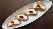 Baguettes with fesh goat cheese and Pimenta Moida. (Fernando Morales/Fernando Morales/The Globe and M)