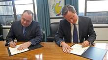 The First Minister of Scotland Alex Salmond (L) and Britain's Prime Minister David Cameron, sign the referendum agreement in St Andrew's House, Edinburgh, Scotland October 15, 2012. Scotland took a big step on its path towards an independence referendum when its leader met Britain's prime minister to finalise arrangements for a vote which could lead to the demise of Scotland's three-centuries-old union with England. (Gordon Terris/Pool/Reuters)