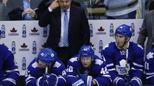 Toronto Maple Leafs head coach Randy Carlyle looks on with his team during a break in play with players (L-R) Phil Kessel, Tyler Bozak, and James van Riemsdyk against the St. Louis Blues during the second period of their NHL game in Toronto, Tuesday March 25, 2014 (Mark Blinch For The Globe and Mail)