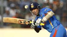 In this Friday, March 16, 2012 file photo, Indian cricketer Sachin Tendulkar bats on his way to scoring a century during the Asia Cup cricket match against Bangladesh, in Dhaka, Bangladesh. India's batting great Tendulkar has announced Sunday, Dec. 23, 2012 his retirement from one-day cricket. (Aijaz Rahi /AP)