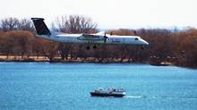 A Porter Airline plane lands at the Billy Bishop island airport. (Boris Spremo For The Globe and Mail)