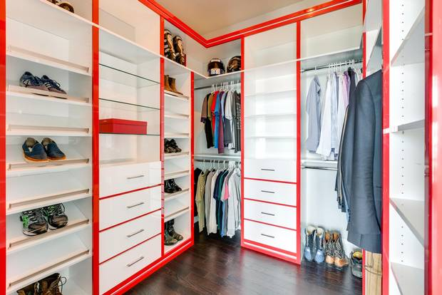 One of the master bedroom's two walk-in closets.