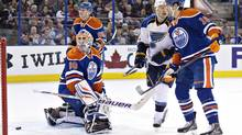 St. Louis Blues' Brenden Morrow (10) screens as Edmonton Oilers goalie Ilya Bryzgalov (80), Martin Marincin (85) and Justin Schultz (19) look for the puck as it goes in the net for a goal during first period NHL action in Edmonton, Alta., on Tuesday January 7, 2014. (JASON FRANSON/THE CANADIAN PRESS)