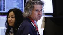In this Thursday, Jan. 2, 2014, file photo, Donald Civitanova, a floor official with Knight Capital, works at the New York Stock Exchange, in New York. (Mark Lennihan/AP)