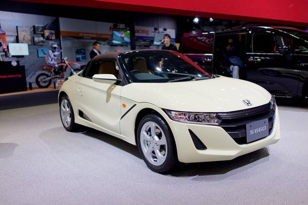 The Honda S660 at the Tokyo Auto Show. The introduction of kei jidosha, or little cars, in the 1950s, got many Japanese people off motorcycles and into cars.