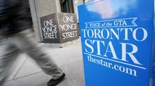 A pedestrian walks past a Toronto Star newspaper box in front of the Toronto Star building at One Yonge Street in Toronto January 18, 2008. (MARK BLINCH/REUTERS)