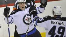 Winnipeg Jets forward Mark Scheifele (L) celebrates his first period goal against the Columbus Blue Jackets with teammate forward Ben Maxwell (49) during the first period of NHL pre-season action in Winnipeg September 20, 2011. (FRED GREENSLADE/REUTERS)