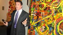 Sylvester Stallone, star of the Rocky and Rambo movies, with one of his paintings at the Art Basel Miami Beach fair.