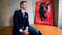 Mark Johnson, pictured in his King Street office, fulfilled a lifelong dream when he ran with the bulls in Pamplona in July. (Galit Rodan/The Globe and Mail)