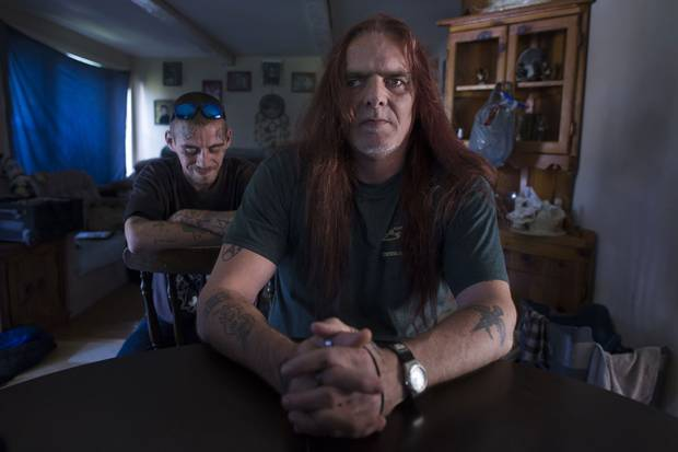 Byron Ruttan, right, and his son Bryon live in a small rented home in Verona, Ont., near Kingston. Both men are dealing with the anger and lasting trauma of the abuse suffered by the elder Mr. Ruttan as a child.