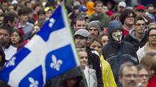 Demonstrators march to protest tuition hikes and Bill 78 in downtown Montreal, Quebec on June 2, 2012. (CHRISTINNE MUSCHI/Reuters)