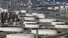 Marathon Oil's Texas City refinery is shown in this file photo. The company is in talks to sell a portion of its stake in the Athabasca Oil Sands Project in Alberta. (David J. Phillip/AP)