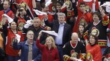Prime Minister Stephen Harper waves a rally towel with fans before the Ottawa Senators face the New York Rangers in Ottawa on April 18, 2012. (BLAIR GABLE/REUTERS)