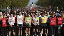 Undaunted by the Boston Marathon bombings, big crowds lined the route of the London Marathon. Runners paid respects to the Boston victims by wearing black ribbons and holding a 30-second silence before the start. (REUTERS/Luke MacGregor)