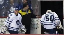 Toronto Maple Leafs goalies Jonas Gustavsson and James Reimer head to the dressing room following their loss to Vancouver Canucks in their NHL hockey game in Vancouver, British Columbia February 18, 2012. (Reuters)
