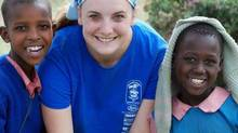 Madeline Payne with Maasai children in Kenya. (Free the Children)