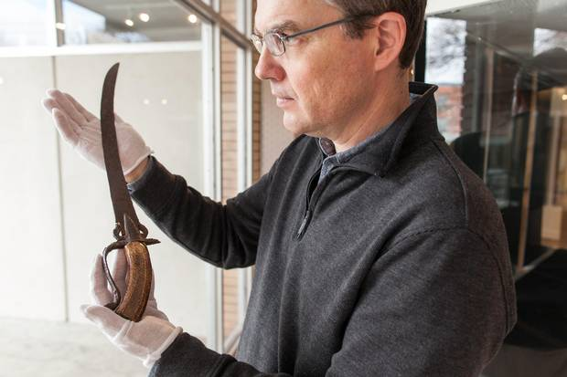 Dennis Oomen, curator the City of Penticton Museum, holds a Spanish sword that was discovered on the grounds of the O'Keefe Ranch in the North Okanagan near Vernon, B.C.