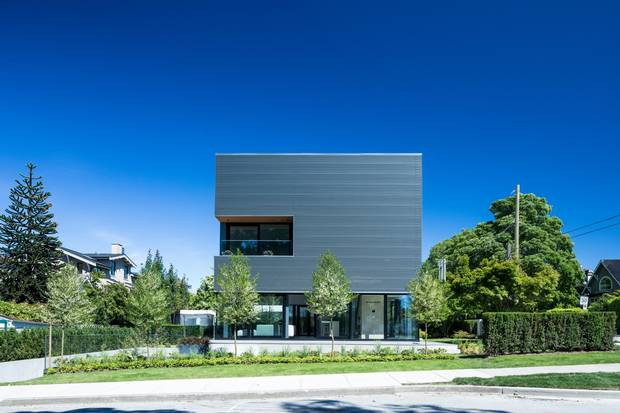 The black, galvanized steel-clad house at 3691 Point Grey Rd.