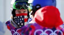 U.S. snowboarder Shaun White waits in line during a breakdown of the chairlift at snowboard slopestyle training for the 2014 Sochi Winter Olympics in Rosa Khutor, February 3, 2014. (MIKE BLAKE/REUTERS)