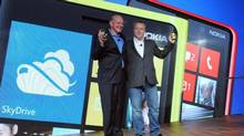 Microsoft CEO Steve Ballmer, left, and Nokia president and CEO Stephen Elop unveil the Nokia Lumia 920 and Nokia Lumia 820 in New York, Sept. 5, 2012. (Diane Bondareff/AP)