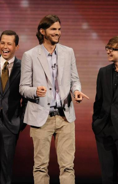 "Ashton Kutcher, the 35-year-old actor who replaced Charlie Sheen after his ouster from the hit TV show in 2011, topped the list for the second consecutive year with $24-million. ""TV's highest-paid actor is laughing all the way to the bank since replacing Sheen on 'Two and a Half Men' after the troubled star's 2011 flameout,"" said Forbes, adding that Kutcher is also an investor in technology companies. (JEFFREY R. STABB/CBS)"