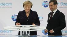 German Chancellor Angela Merkel and Russian President Dmitry Medvedev arrive to turn a wheel to symbolically start the flow of gas through the Nord Stream Baltic Sea gas pipeline at a cemerony on November 8, 2011 in Lubmin, Germany. (Sean Gallup/Sean Gallup/Getty Images)