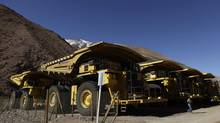 In this May 23, 2013 photo, mining trucks sit parked on the facilities at the Barrick Gold Corp.'s Pascua-Lama project facilities in northern Chile. (Jorge Saenz/AP)