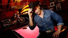 Singer-songwriter Corb Lund tips his hat at the Horseshoe Tavern in Toronto, Aug. 30, 2012. (Peter Power/The Globe and Mail)