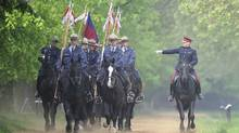 Captain Richard Chambers, right, riding master of the Household Cavalry, takes Royal Canadian Mounted Police for a training session in Hyde Park, London on May 22, 2012. (PAUL HACKETT/PAUL HACKETT/Reuters)