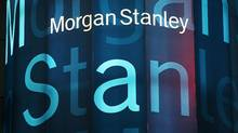 Stock tickers light up Morgan Stanley headquarters in New York. (Mark Lennihan/AP)