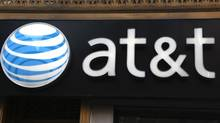 This May 6, 2012, file photo, shows an AT&T sign at a store in New York. (CX Matiash/AP)