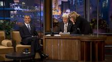"President Barack Obama smiles while Jay Leno talks with executive producer Debbie Vickers during a break in taping on ""The Tonight Show with Jay Leno"" in Burbank, Calif., Oct. 24, 2012. (DAMON WINTER/NYT)"