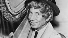 Harpo Marx, the wigged, non-speaking member of the Marx Brothers (AP)