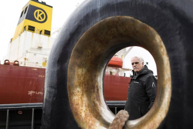 Vice-president of the B.C. Coast Pilots, Robin Stewart, poses for a photo while on escort of the Eser K oil tanker.