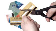 Cutting gold credit card (iStockphoto)