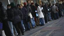 People wait in line to enter a government-run employment office in Madrid Jan. 3, 2013. The outlook for 2013 from analysts is jobs growth in Germany and further joblessness in Spain. (SUSANA VERA/REUTERS)