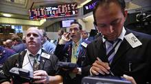 Traders work on the floor of the New York Stock Exchange, September 20, 2012. (BRENDAN MCDERMID/REUTERS)