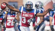 Montreal Alouettes' Kyries Hebert celebrates after intercepting the ball during second half CFL football action against the Saskatchewan Roughriders in Montreal, Sunday, September 16, 2012. (The Canadian Press)