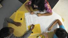Grade 6 students work as a group on their EQAO standardized test preparations at Lougheed Middle School in Brampton, Ont., on May 16, 2013. (J.P. MOCZULSKI FOR THE GLOBE AND MAIL)